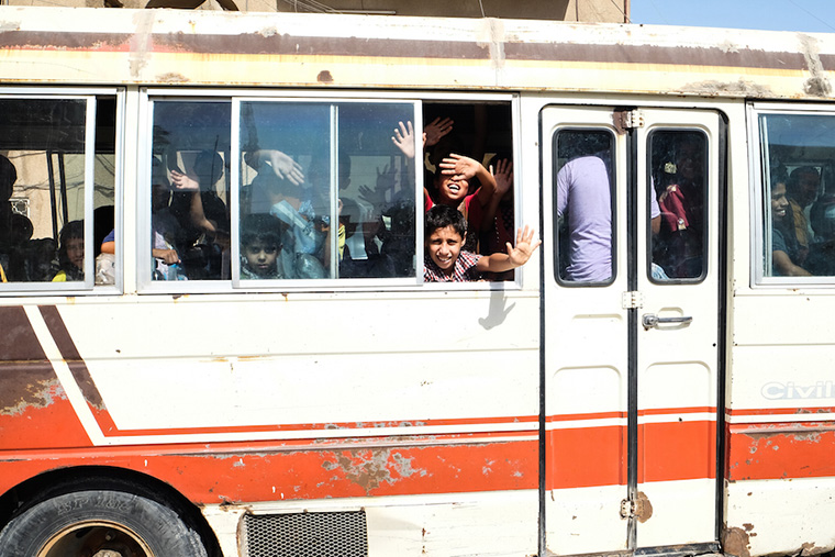 Children piled into a bus, shuttled back home after lesson and a meal at a local community center.