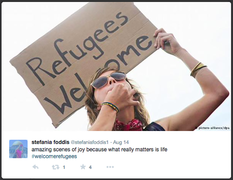 Twitter has been filling up with #refugeeswelcome messages, like this photo of a woman holding a large cardboard sign.