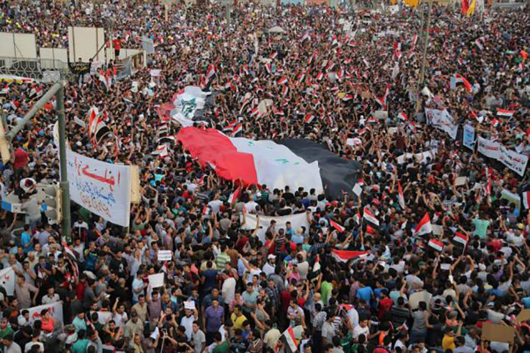 In the late summer heat, in the middle of power outages, Iraqi protesters fill Baghdad's Tahrir Square, demanding change from the government.