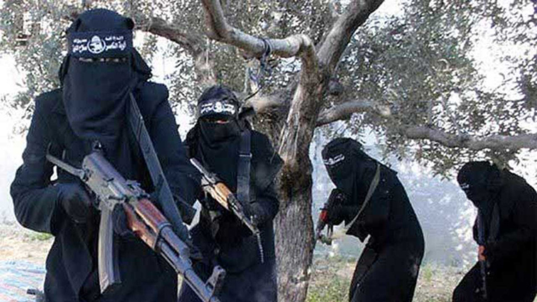Women loyal to ISIS, dressed from head to toe in loose black clothing, hold guns.