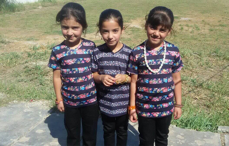 The children of Mukasheefa in their new clothes!