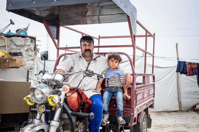 Mohammad looks serious, but he's thrilled to have a business to support his family.