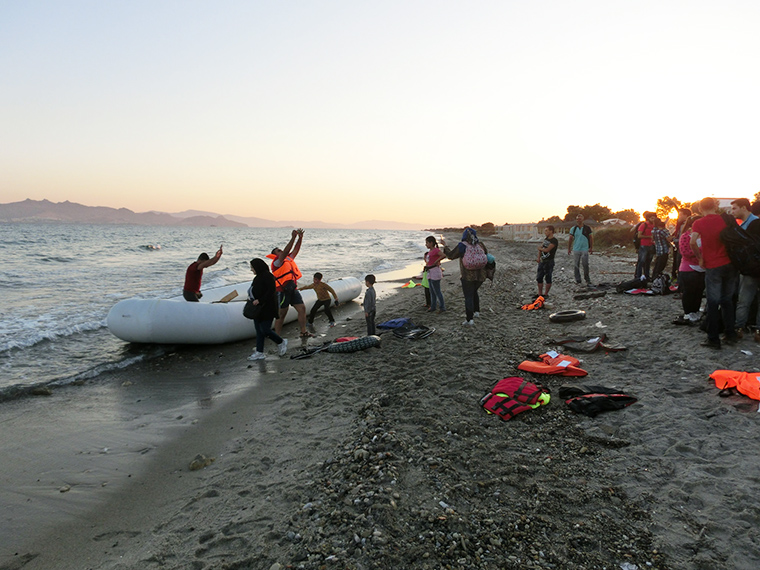 A rubber boat carrying around 50 migrants and refugees arrives from Bodrum in Turkey to the Greek island of Kos in the early hours of the morning.