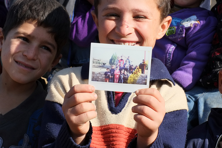 Instant photos go over well with the kids we serve. So many families displaced by ISIS no longer have any family photos, so it's a gift we love to give!