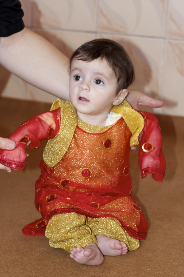 Baby Honey in her traditional Kurdish clothes.