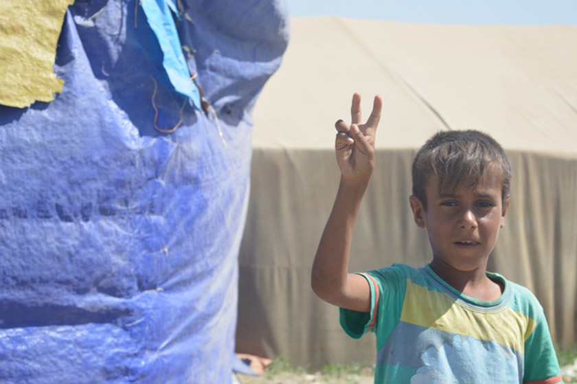 A Fallujan boy, displaced by ISIS, flashes the victory sign.