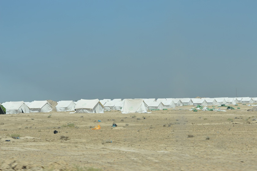 The displacement camp set in the desert.