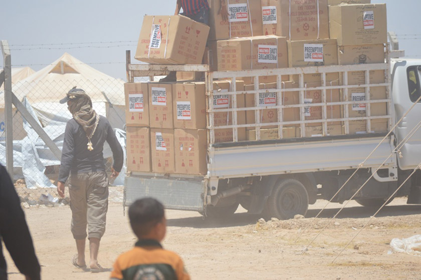 Trucks piled high with stoves make their way through a displacement camp south of Fallujah. You brought hope and comfort there.