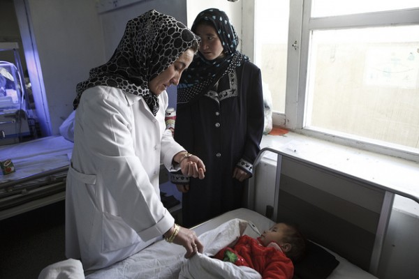 An Afghani doctor cares for a child.