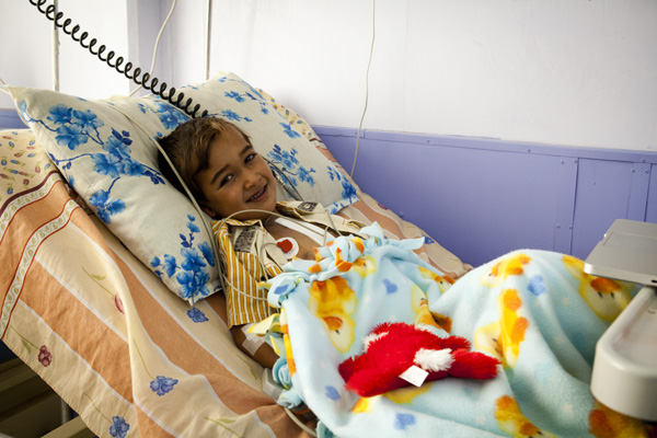 Mohammed, a young Iraqi boy, resting after receiving heart surgery in southern Iraq.