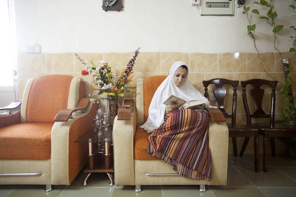 Kurdish girl reading the Koran during Ramadan