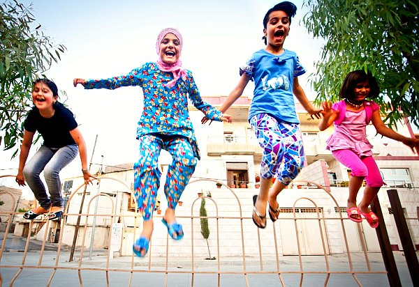Four Iraqi girls play together in their neighborhood in northern Iraq.