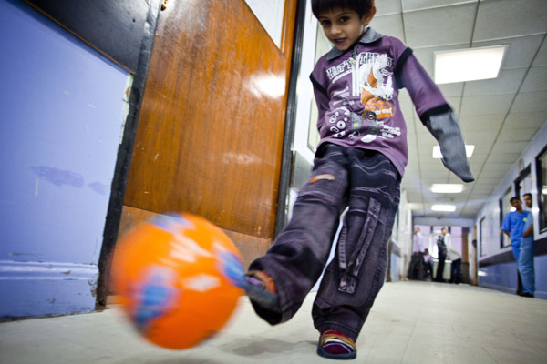 A photo of Mohammed kicking a ball in the children's ward.
