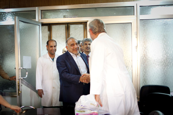 A photo of H.E. Adel Abdul Mahdi shaking hands with Dr. Novick