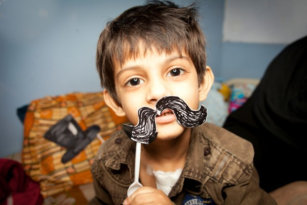 Mohammad from Pakistan tries out a handlebar moustache in our Remedy Photobooth.