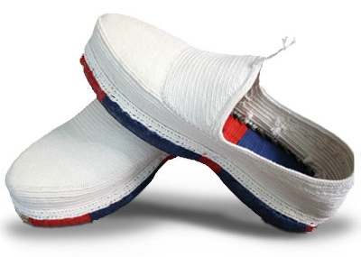 A photo of a pair of handmade red and blue Kurdish Klash shoes.