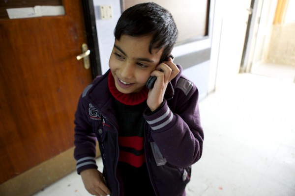A photo of Ali Abdel calling his dad to share about his upcoming surgery!