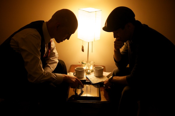 A photo of Jeremy Courtney and Cody Fisher working at a cafe.