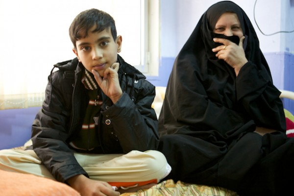 Ali and his mother sit together after Ali's successful surgery.