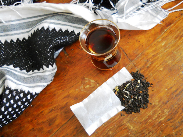 A photo of Kurdish chai tea and a traditional Kurdish jamana scarf.
