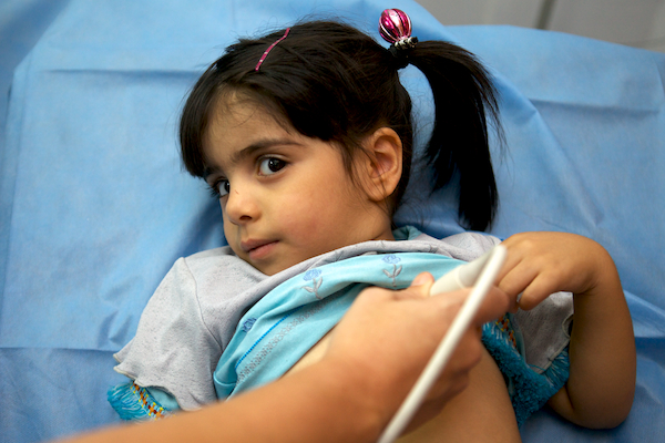 A photo of the cutest little Iraqi girl ever getting screened at al-Sadr Hospital in Najaf, Iraq.