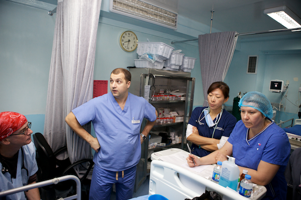 A photo of Pavel, the intensivist for Remedy Mission XIV in Basra, Iraq, doing rounds in the ICU.