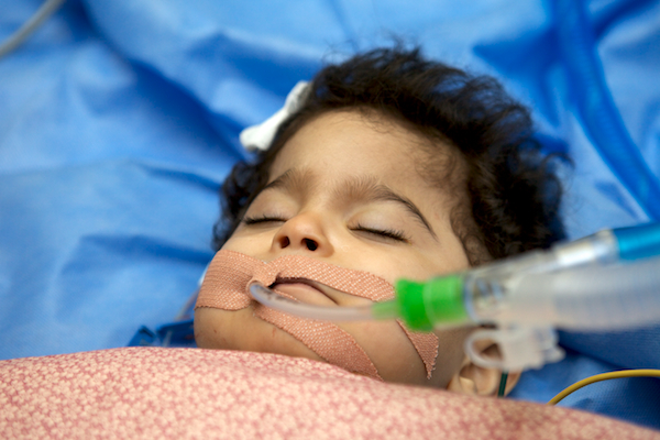 A photo of a little girl from Najaf named Zainab, who received a lifesaving heart surgery in September 2012.