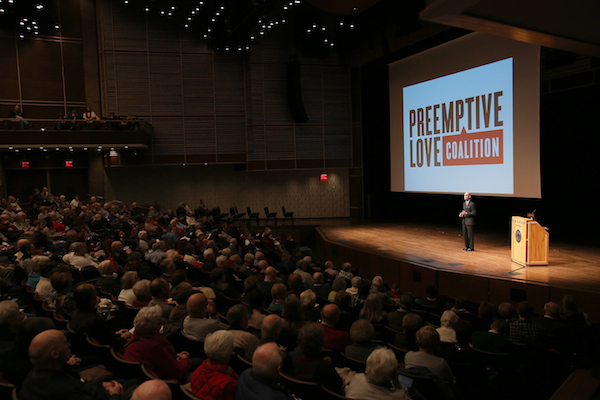 A photo of Preemptive Love Coalition staff speaking at Calvin College.