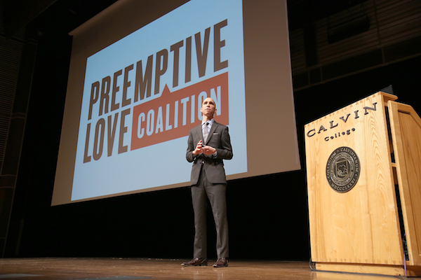 A photo of Jeremy Courtney speaking at Calvin College's January Series.