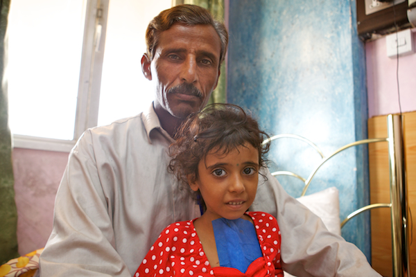 A photo of Zahraa and her father waiting in their room at the hospital in Najaf, Iraq.