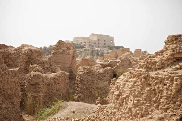A photo of the ruins of Babylon with Saddam's former palace on the hilltop behind them near Hilla, Iraq.