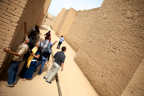 A photo of the Remedy Mission XII team touring the inner city of Babylon with a tour guide.