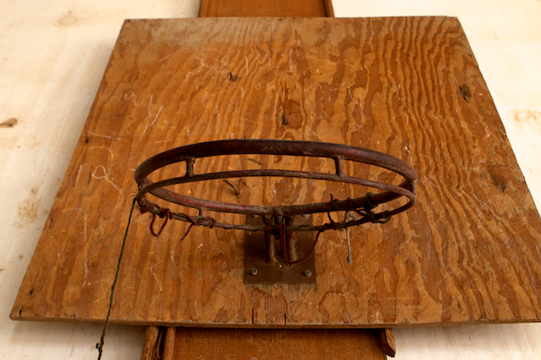 An old makeshift basketball hoop hung in the former sitting room of Saddam's Babil palace.