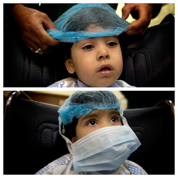 A diptic of Zahraa in her wheelchair heading up to the children\'s ward.