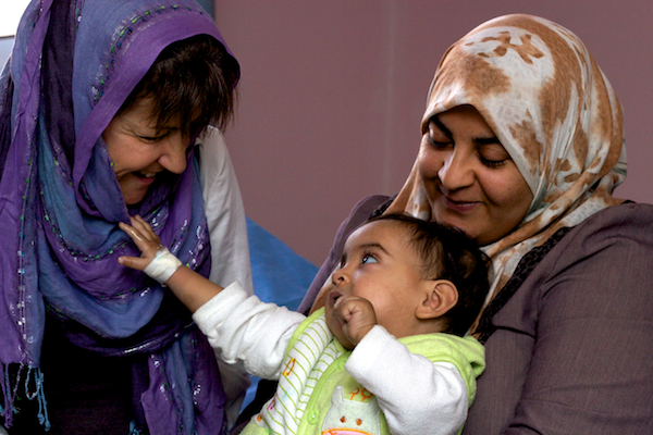 A photo of a baby from Fallujah, her mother, and the cardiologist who saved her life.