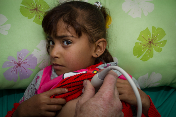 A photo of Israa getting her pre-op echo in Tikrit General Hospital.