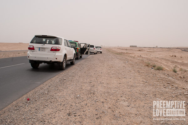 A photo of the caravan of SUVs traveling from Fallujah to Tikrit.