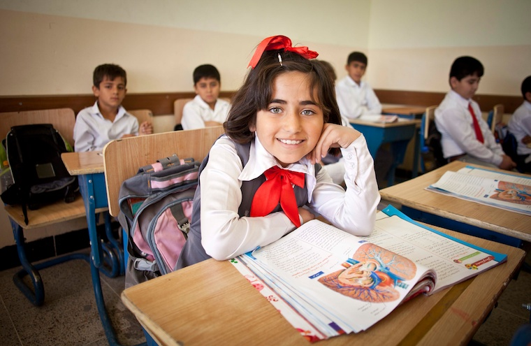 A student poses at a school in Iraq