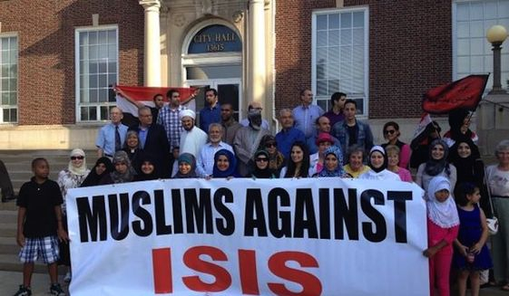 Muslims display a banner in opposition to ISIS
