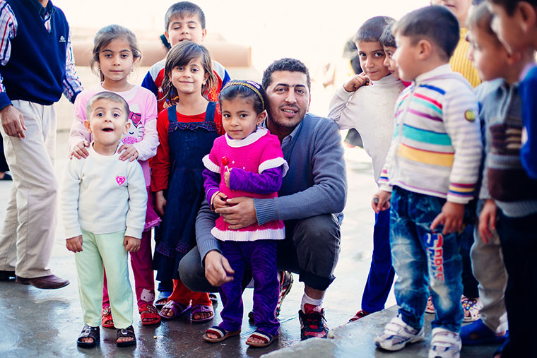 A Kurdish volunteer spends time with IDP children displaced by the war with ISIS.