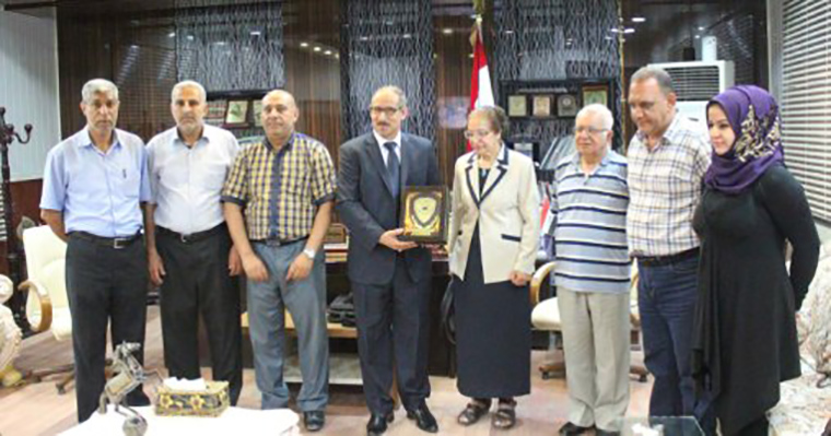 The Babel Chamber of Commerce presented Madiha al-Birman (center) with a plaque in appreciation.