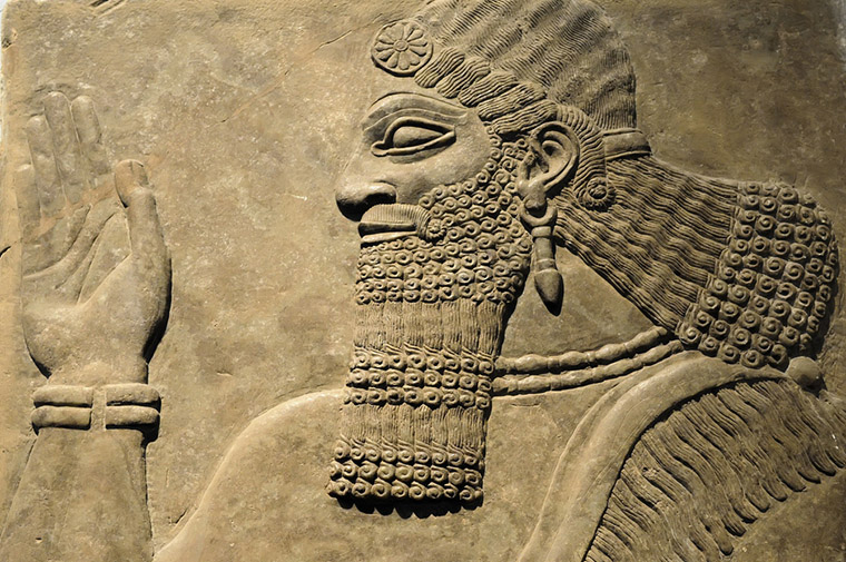 An ancient relief carving of an Assyrian man.