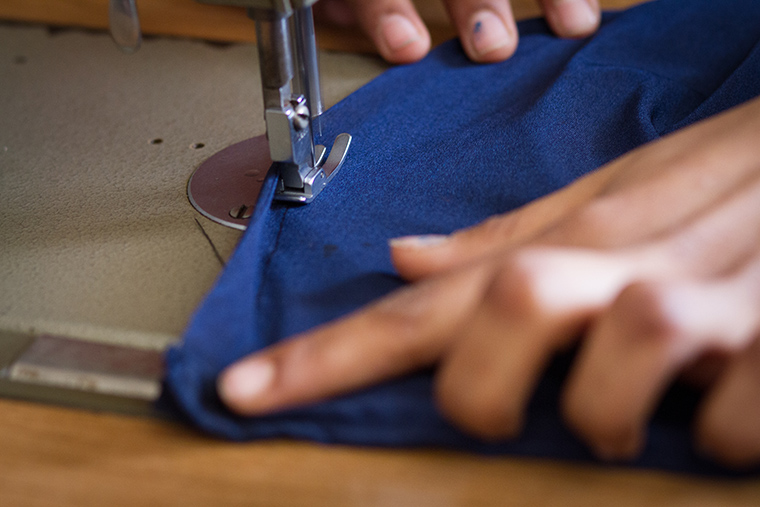 Sewing up the side seams of a new dress.