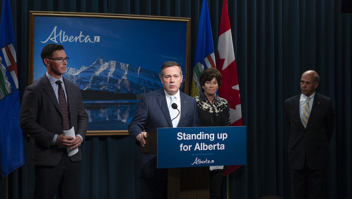 Steve Allan, Sonya Savage, and Jason Kenney on stage at the initial announcement of the public inquiry