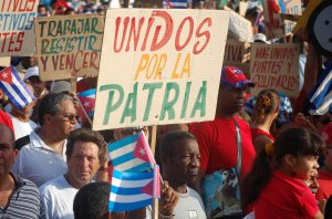 Masses of Cubans march to show their continued support for their Revolution and for socialism.