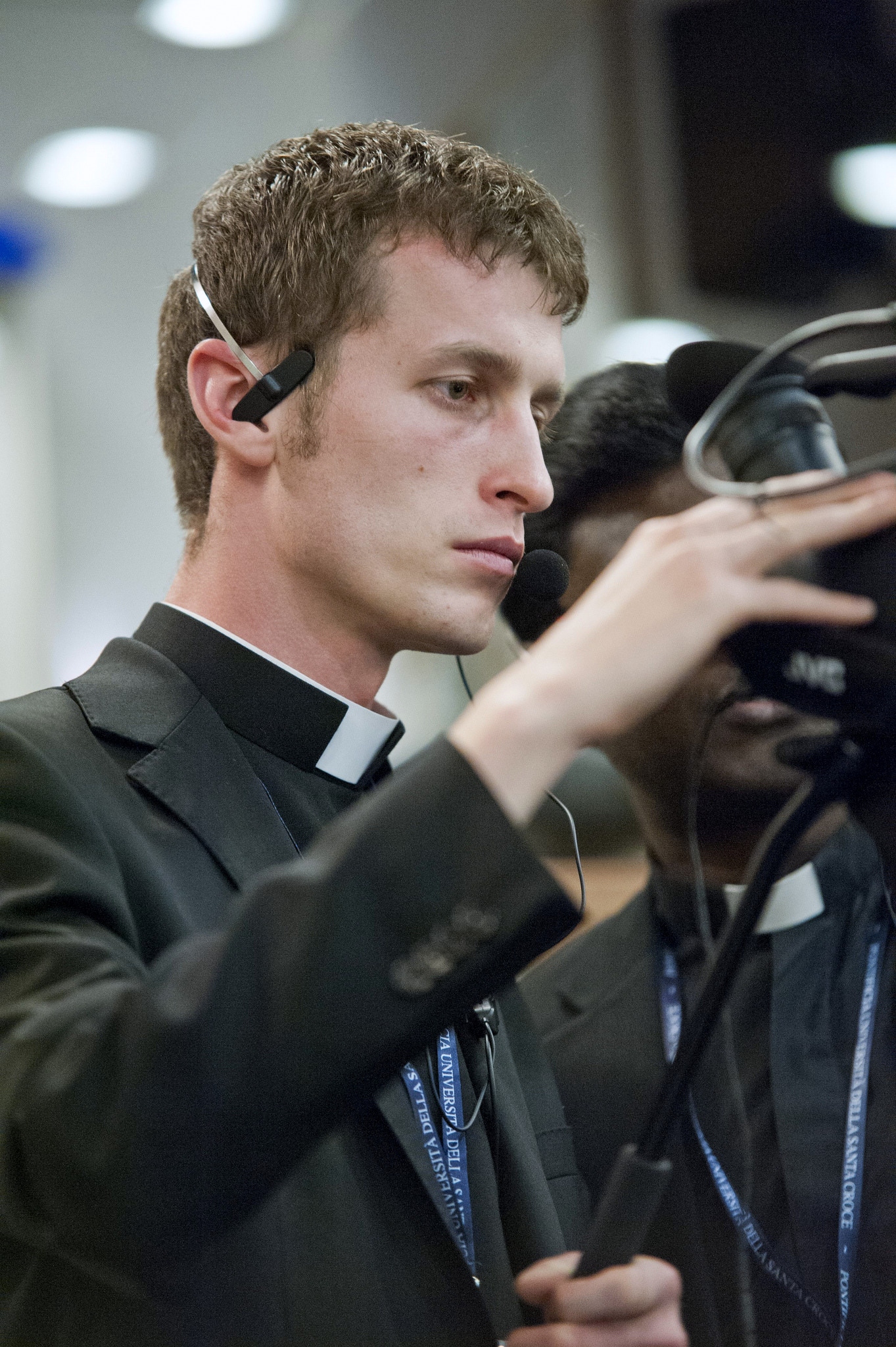 priest_with_video_camera.jpg