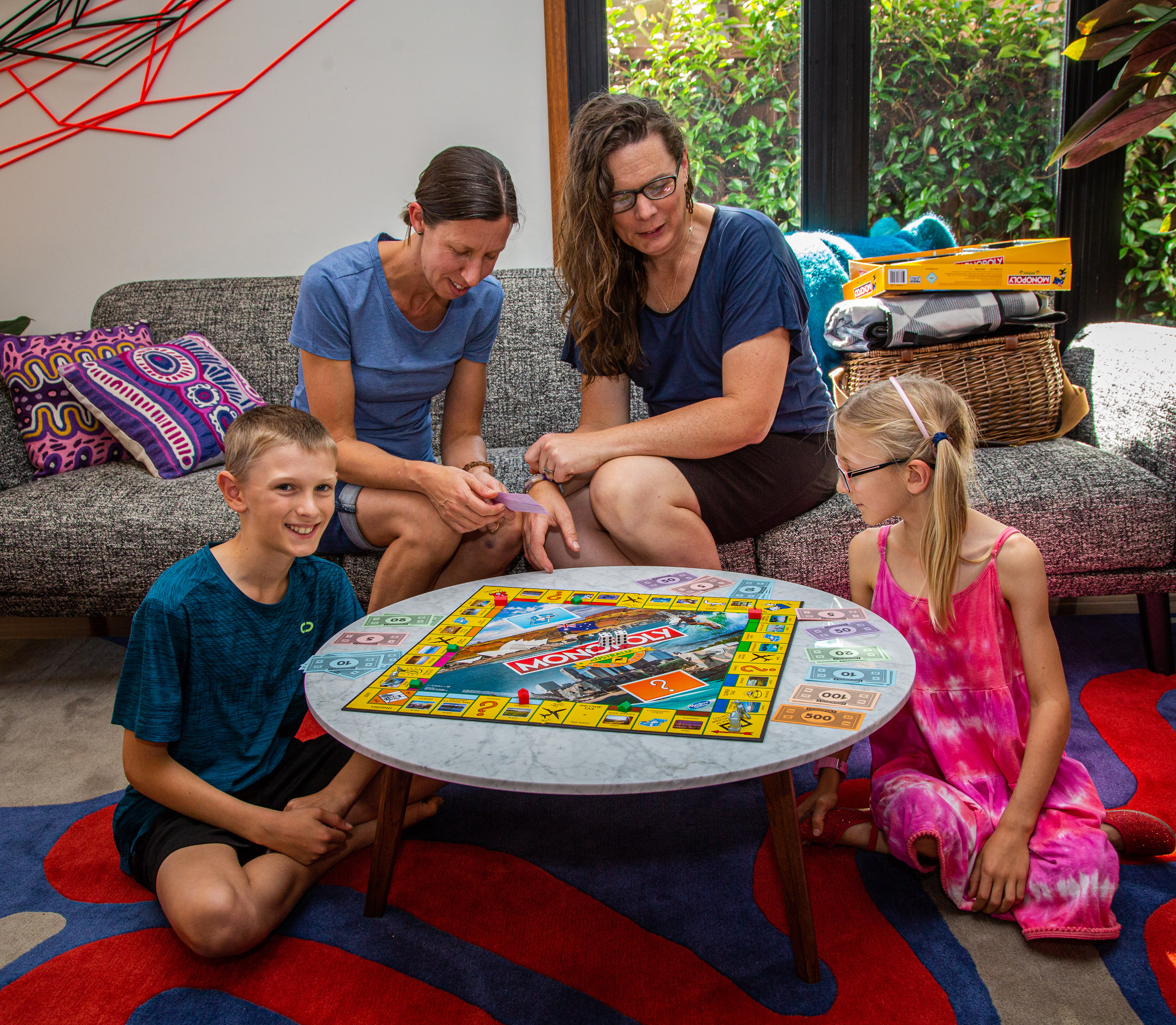 LGBTQ Family playing Monopoly