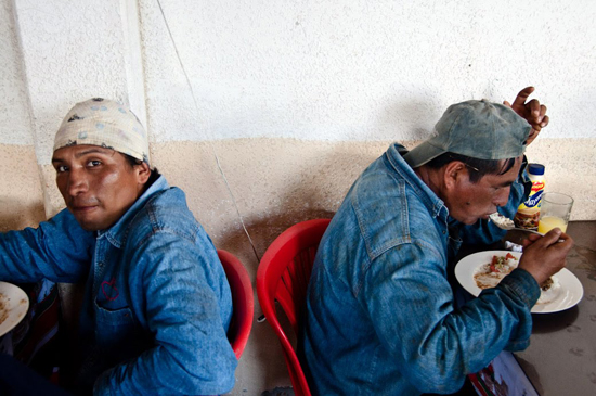 Two oil workers eating in a cafeteria in Taracoa.
