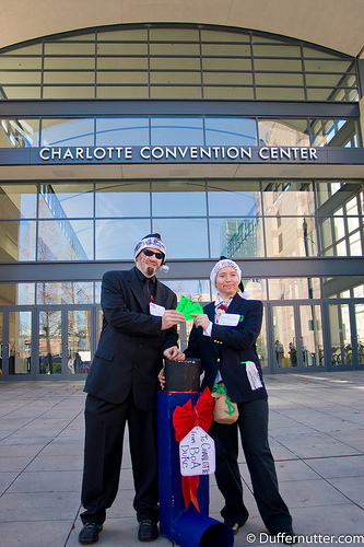 RAN and Greenpeace Activists Dressed as Bank of America and Duke Energy CEOs Present City of Charlotte, NC with Giant Inhaler