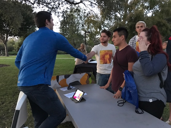Cal Poly San Luis Obispo students engage with a Pepsi recruiter on campus.]